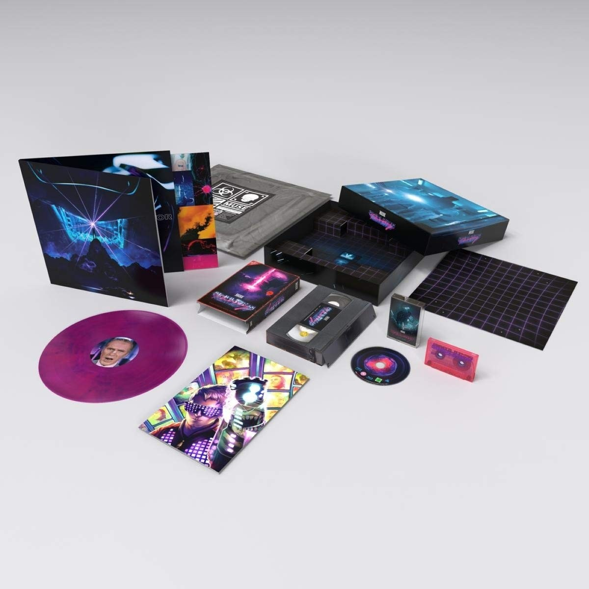 "MUSE brings their Simulation Theory tour to life in this limited edition 80s-inspired deluxe box set. Vinyl / 12"" Album with Blu-ray and Cassette"